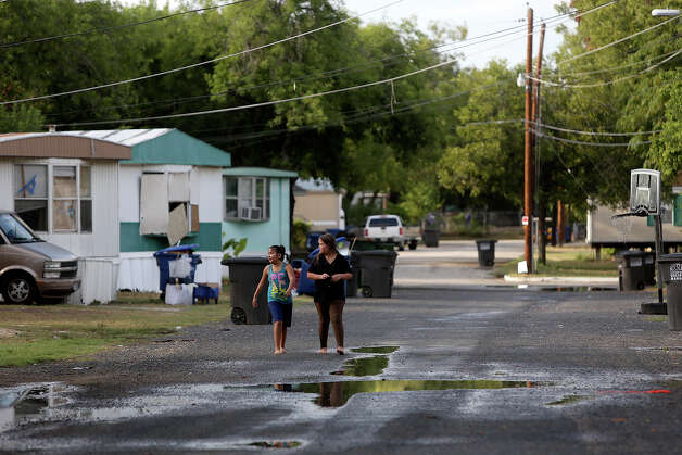 Stephanie Perez, 7, left, and Labella Valenzuela, 9, entrain themselves at the Mission Trails Mobile Home Park in San Antonio on Tuesday, Sept. 16, 2014. Photo: Lisa Krantz / SAN ANTONIO EXPRESS-NEWS