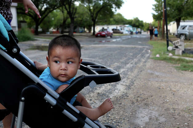 Six-month-old Daniel De La Cruz is the youngest of four children in his family living at the Mission Trails Mobile Home Park in San Antonio on Tuesday, Sept. 16, 2014. His parents cannot afford the costs of moving the trailer they have invested in to another park and do not know what they will do. Photo: Lisa Krantz / SAN ANTONIO EXPRESS-NEWS