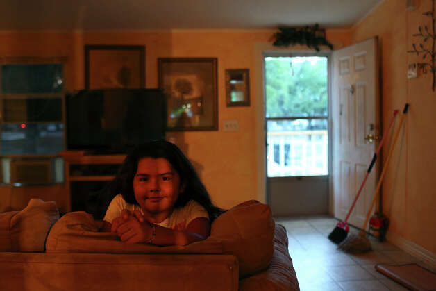 Valerie Araugo, 7, doesn't want to leave the home she shares with her mother, Brenda Reyna, and her brother at the Mission Trails Mobile Home Park in San Antonio on Tuesday, Sept. 16, 2014. Photo: Lisa Krantz / SAN ANTONIO EXPRESS-NEWS