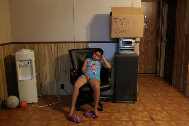 Stephanie Perez, 7, sits in her mobile home amid the remnants of her family's belongings being packed up to move from their trailer at the Mission Trails Mobile Home Park in San Antonio on Tuesday, Sept. 16, 2014. Photo: Lisa Krantz / SAN ANTONIO EXPRESS-NEWS