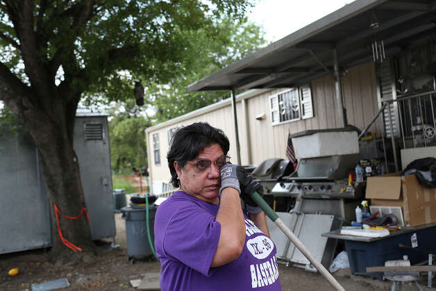 Mary Flores becomes emotional as she talks about being forced out of Mission Trails mobile home park after living there for 38 years as she works in her yard on Wednesday, August 27, 2014. Photo: Lisa Krantz / SAN ANTONIO EXPRESS-NEWS