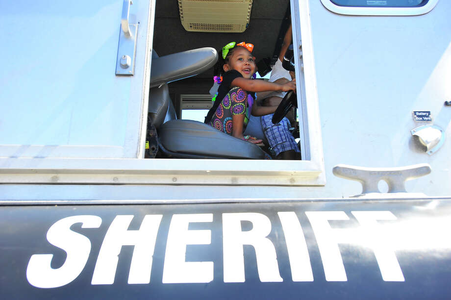 Nariah Thomas, 3, enjoys a visit inside the Jefferson County Sheriff's patrol boat during the Fire Prevention and Family Safety Festival at the Fire Museum of Southeast Texas in Beaumont Saturday. Photo taken Saturday, October 4, 2014 Kim Brent/@kimbpix Photo: KIM BRENT / Beaumont Enterprise