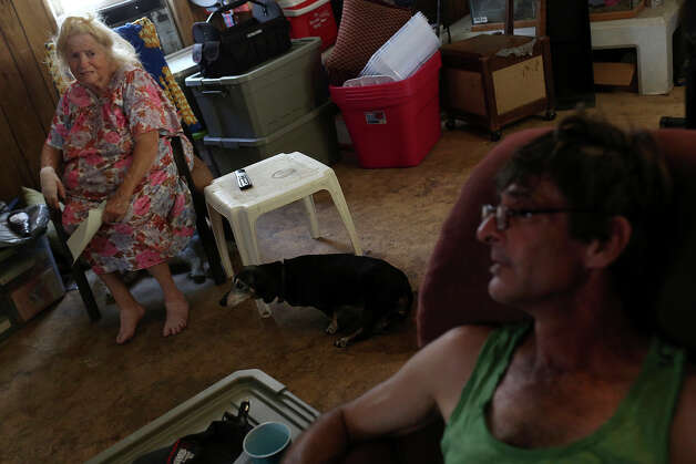 Carol Thompson is being forced out of Mission Trails mobile home park with her son, Jeffrey Draper, right, and their dog, Tickles, after living there for 10 years, on Wednesday, August 27, 2014. Photo: Lisa Krantz / SAN ANTONIO EXPRESS-NEWS