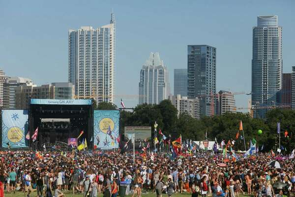 A crowd gathers at Zilker Park for the Austin City Limits Music Festival on Saturday, Oct. 4, 2014, in Austin, Texas. (Photo by Jack Plunkett/Invision/AP)