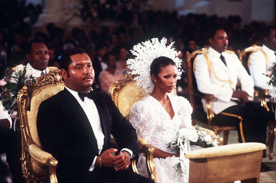 "FILE - In this May 27, 1980 file photo, then Haitian president Jean-Claude Duvalier, left, is pictured with his bride,  Michele Bennett, during their wedding ceremony in the Port-au-Prince National Cathedral in Haiti.  Duvalier, the self-proclaimed ""president for life"" of Haiti whose corrupt and brutal regime sparked a popular uprising that sent him into a 25-year exile, died Saturday, Oct. 4, 2014 of a heart attack, his attorney said.  He was 63.  (AP File Photo) Photo: Associated Press / ap"