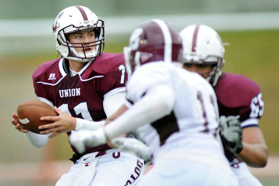 Union's quarterback Connor Eck, left, looks to pass during their football game against Springfield on Saturday, Oct. 4, 2014, at Union College in Schenectady, N.Y. (Cindy Schultz / Times Union) Photo: Cindy Schultz / 10028825A