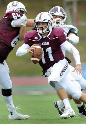 Union's quarterback Connor Eck, center, carries the ball during their football game against Springfield on Saturday, Oct. 4, 2014, at Union College in Schenectady, N.Y. (Cindy Schultz / Times Union) Photo: Cindy Schultz / 10028825A