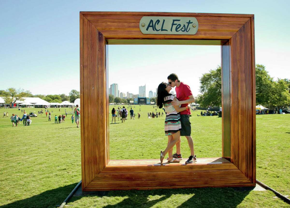 Christine Choi kisses her fiance Kyle Ruiz at the Austin City Limits Music Festival in Zilker Park, Friday, Oct. 3, 2014, in Austin, Texas.