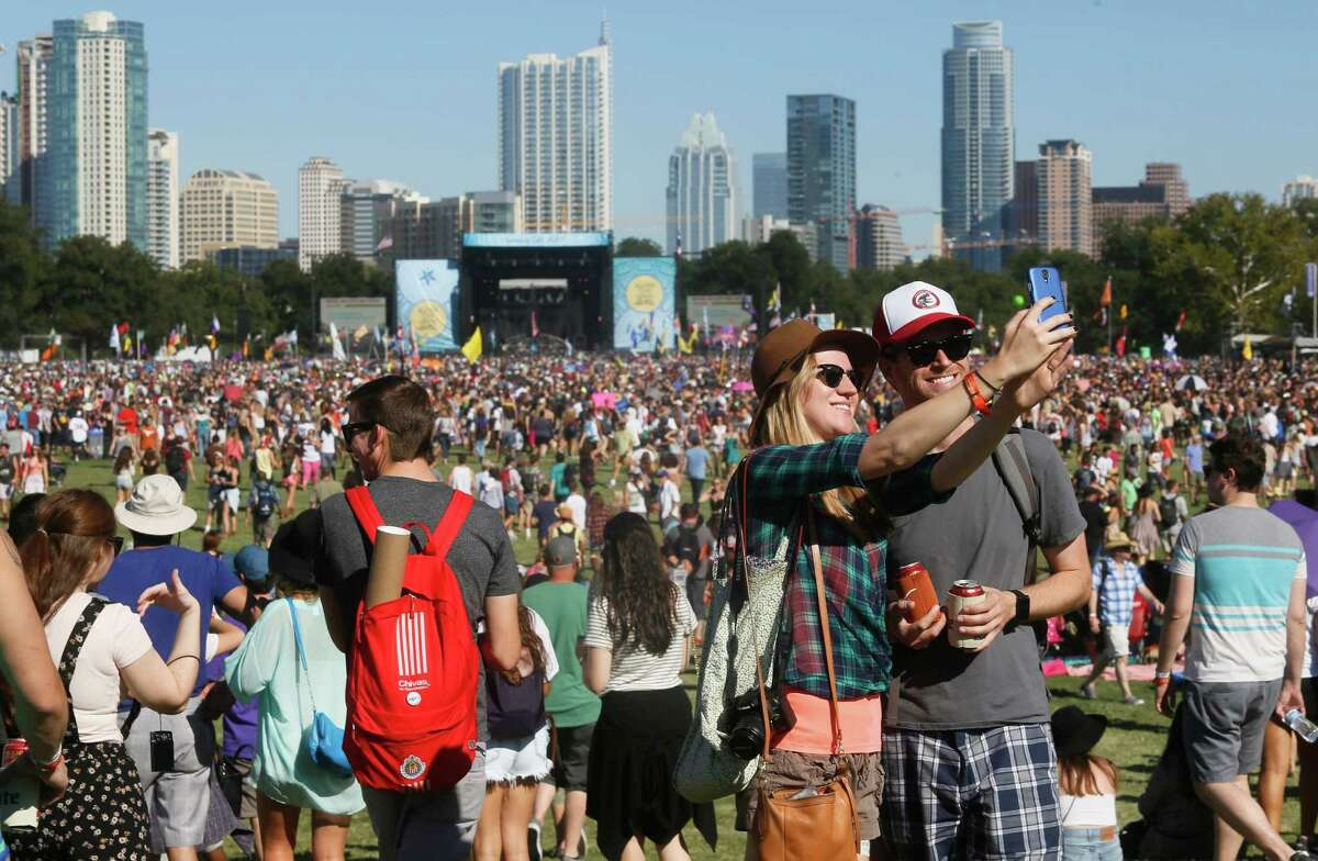 John and Sara Vershaw take a selfie photo at the Austin City Limits Music Festival on Saturday, Oct. 4, 2014, in Austin, Texas.