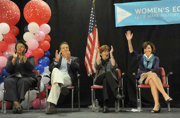Left to right, Albany County Democratic Committee Chairwoman Carolyn McLaughlin,Gov. Andrew Cuomo ,Albany Mayor Kathy Sheehan and LG Nominee Kathy Hochul attend at rally to build support for the women's equality agenda at the Albany Labor Temple on Saturday Oct. 4, 2014 in Albany, N.Y.  (Michael P. Farrell/Times Union) Photo: Michael P. Farrell / 00028882A