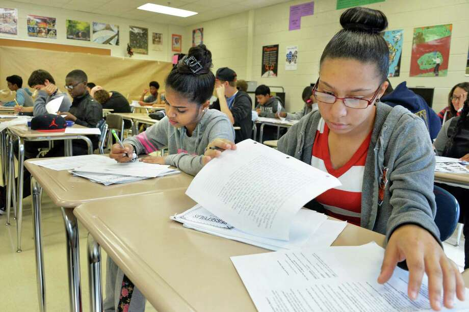 Ninth-graders Kimberly Sammy and Brianna Shackelford, right, in their English Language Arts class at Schenectady High School Thursday Sept. 25, 2014, in Schenectady, NY.  (John Carl D'Annibale / Times Union) Photo: John Carl D'Annibale / 00028753A