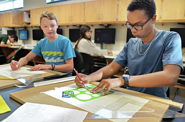 Ninth graders Northern McCullough, left, and Darrius McKoy at work in a design and drawing for production class at Niskayuna High School Friday Sept. 26, 2014, in Niskayuna, NY.  (John Carl D'Annibale / Times Union) Photo: John Carl D'Annibale / 00028756A