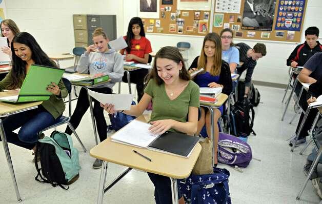 Eleventh grader Rose Parisis, center, in an AP History class at Niskayuna High School Friday Sept. 26, 2014, in Niskayuna, NY.  (John Carl D'Annibale / Times Union) Photo: John Carl D'Annibale / 00028756A