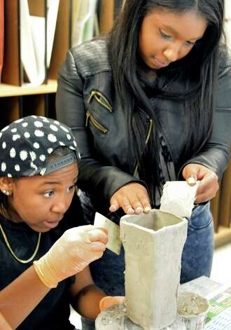 Seniors Jelani Rice, left, and Nasharae Gill work on a ceramics project at Niskayuna High School Friday Sept. 26, 2014, in Niskayuna, NY.  (John Carl D'Annibale / Times Union) Photo: John Carl D'Annibale / 00028756A