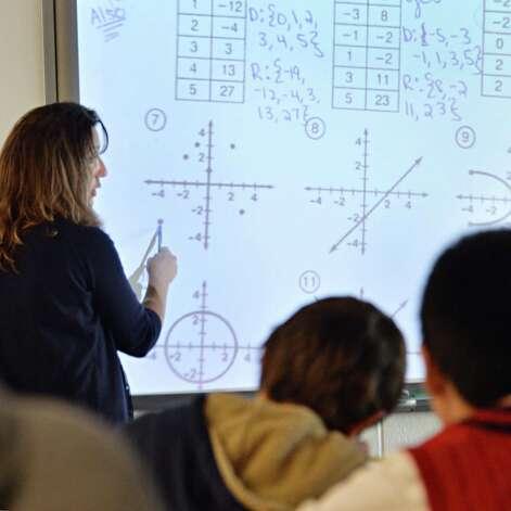 Math teacher Michelle Hawkins uses an interactive whiteboard during an Algebra class at Niskayuna High School Friday Sept. 26, 2014, in Niskayuna, NY.  (John Carl D'Annibale / Times Union) Photo: John Carl D'Annibale / 00028756A