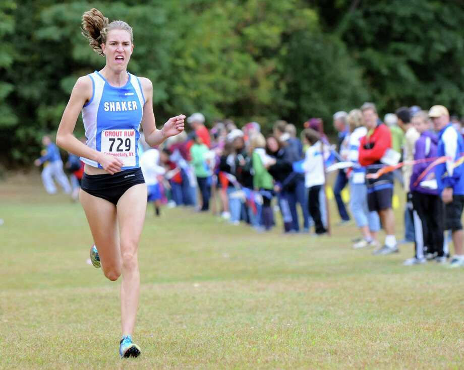 Shaker's Maryanna Lansing runs for the finish line to take first in the Girls' Division I cross country Grout Run on Saturday, Oct. 4, 2014, at Central Park in Schenectady, N.Y. (Cindy Schultz / Times Union) Photo: Cindy Schultz / 00028844A