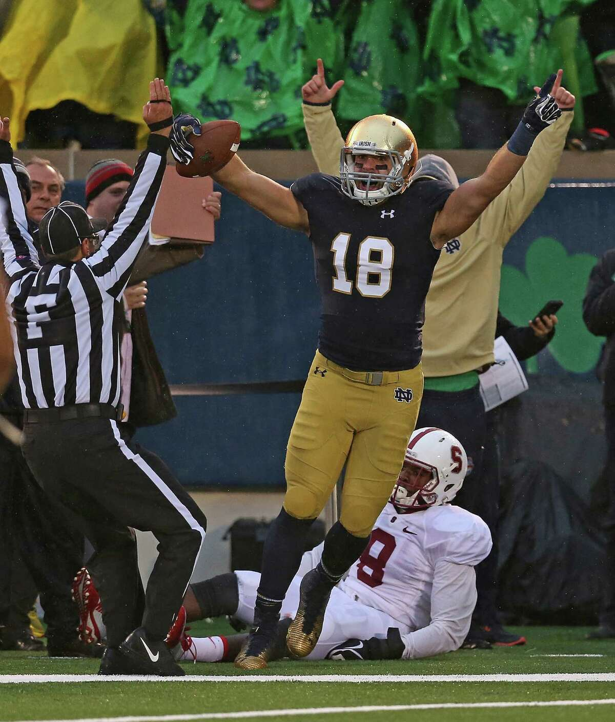 SOUTH BEND, IN - OCTOBER 04: Ben Koyack #18 of the Notre Dame Fighting Irish celebrates catching the game-winning touchdown pass over Jordan Richards #8 of the Standford Cardinal at Notre Dame Stadium on October 4, 2014 in South Bend, Indiana. Notre Dame defeated Standford 17-14. (Photo by Jonathan Daniel/Getty Images)