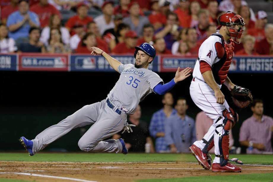 Kansas City Royals' Eric Hosmer (35) slides home to score behind Los Angeles Angels catcher Chris Iannetta in the second inning of Game 2 of baseball's AL Division Series in Anaheim, Calif., Friday, Oct. 3, 2014. (AP Photo/Gregory Bull) ORG XMIT: ANS129 Photo: Gregory Bull / AP