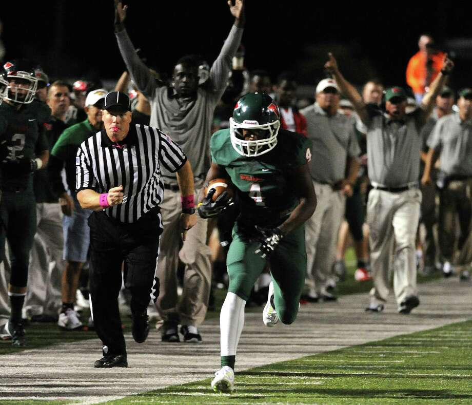 Woodlands wide receiver Chris Bell sprints down the sideline for a 41-yard touchdown during the second half of a high school football game against Atascocita, Saturday, October 4, 2014, at Woodforest Stadium in Shenandoah, TX. Photo: Eric Christian Smith, For The Chronicle / 2014 Eric Christian Smith