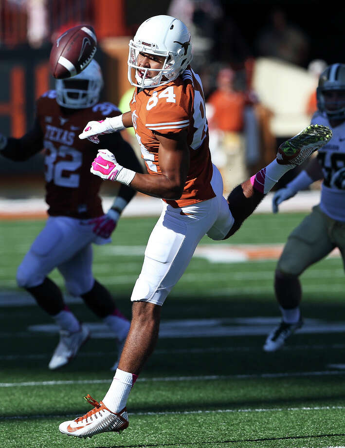 Longhorn receiver Lorenzo Joe watches the ball squirt away on a pass he could catch as UT hosts Baylor at Royal Memorial Stadium on October 4, 2014. Photo: TOM REEL, By Tom Reel, San Antonio Express-News