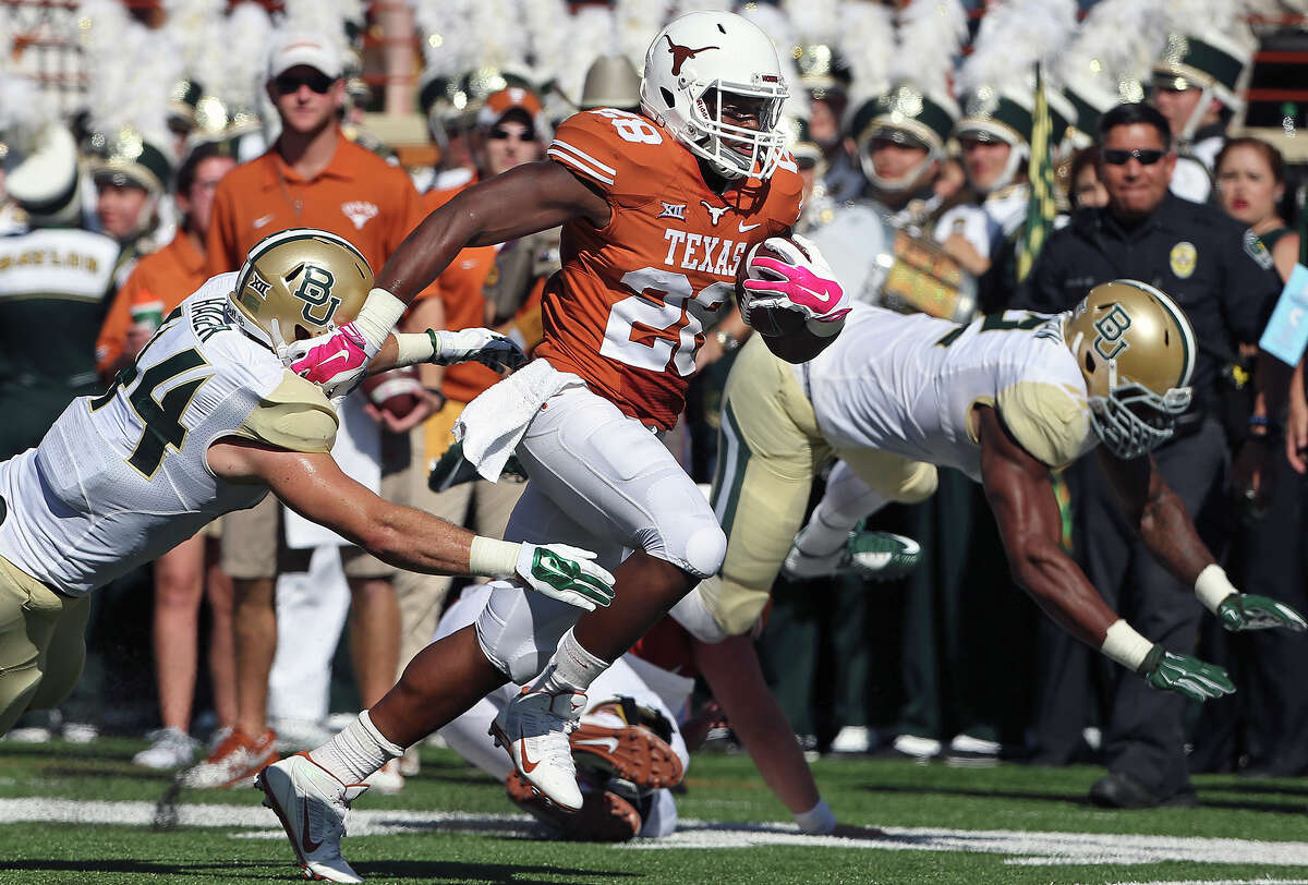 Longhorn running back Malcolm Brown scrambles the field on a run in the second quarter as UT hosts Baylor at Royal Memorial Stadium on October 4, 2014.