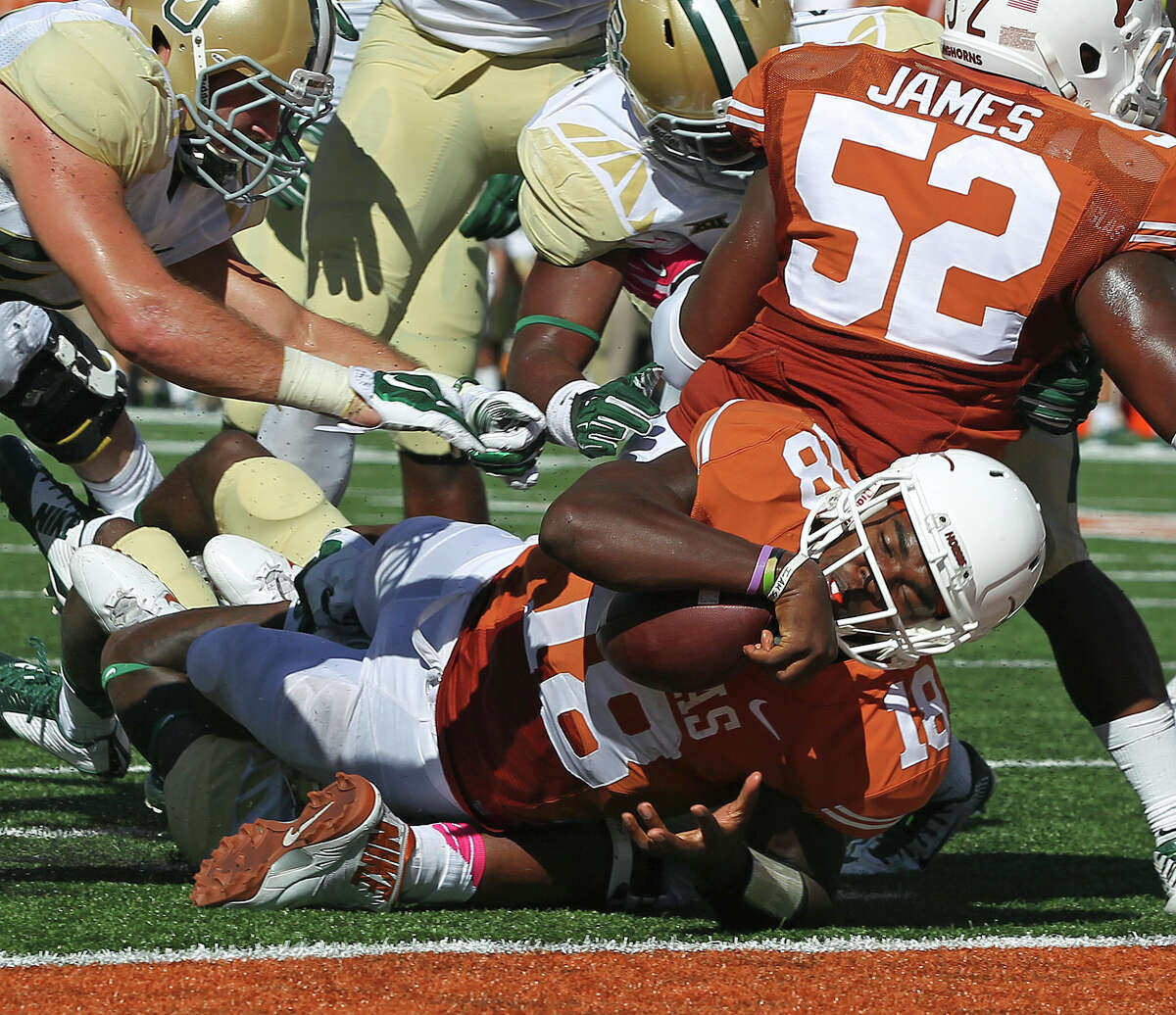 Longhorn quarterback Tyrone Swoopes goes down just shy of the goal line in the second quarter as UT hosts Baylor at Royal Memorial Stadium on October 4, 2014.
