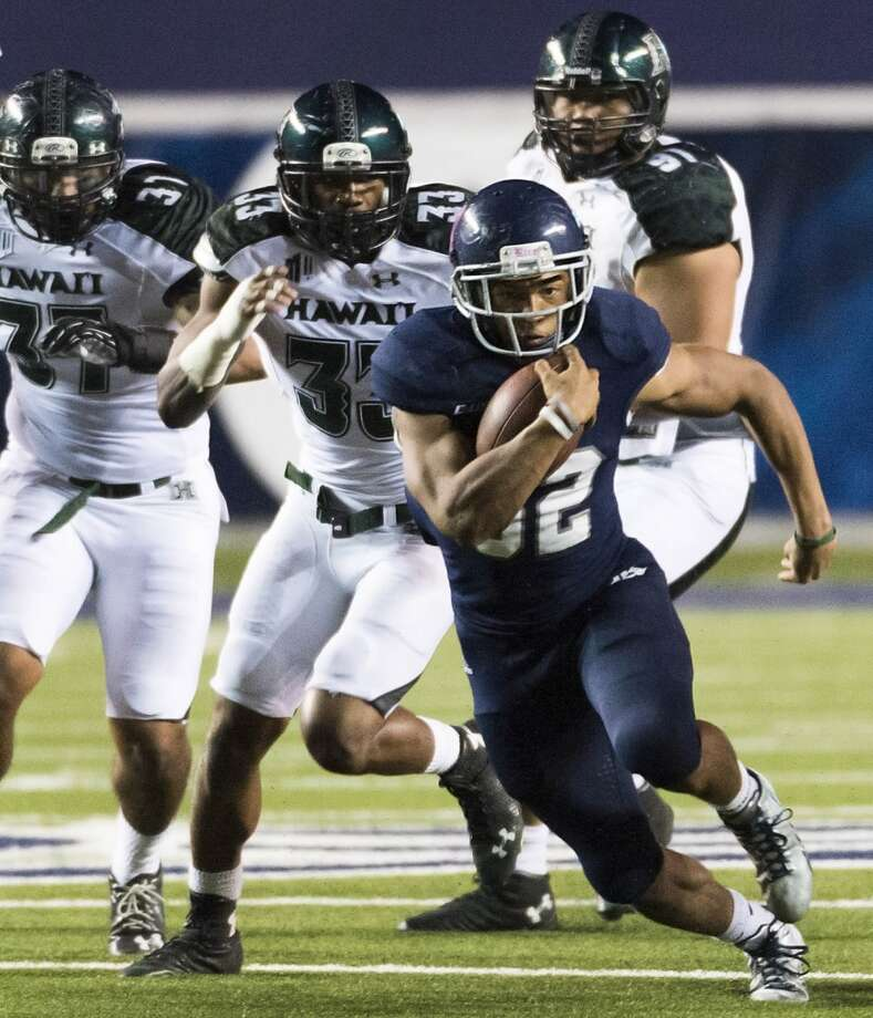 Rice running back Darik Dillard (32), who rushed for 141 yards in the game, races through the Hawaii defense for a 19-yard gain during the fourth quarter of a college football game at Rice Stadium, Saturday, Oct. 4, 2014, in Houston. ( Smiley N. Pool / Houston Chronicle ) Photo: Smiley N. Pool, Houston Chronicle