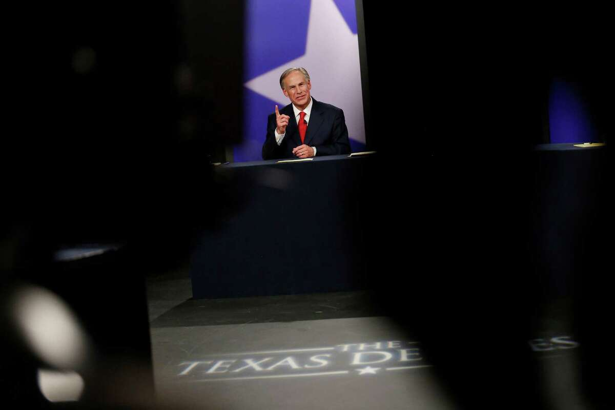 Texas Attorney General Greg Abbott, Republican candidate, answers a question during the final gubernatorial debate with Texas State Senator Wendy Davis, Democratic candidate in a KERA-TV studio in Dallas Tuesday September 30, 2014. (Andy Jacobsohn/The Dallas Morning News)
