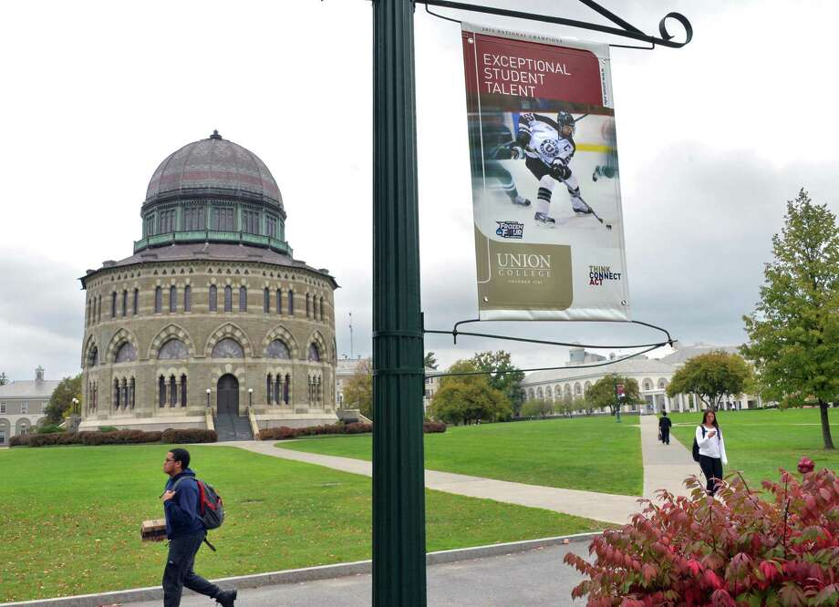 Students make their way across the Union College campus under a banner of their hockey team Wednesday Oct. 1, 2014, in Schenectady, NY.  (John Carl D'Annibale / Times Union) Photo: John Carl D'Annibale / 00028847A