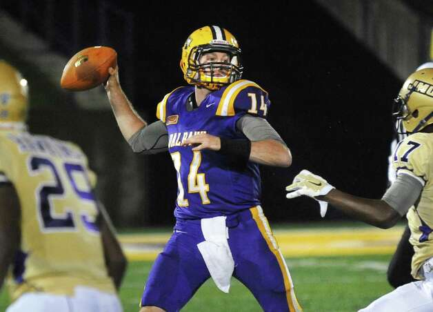 UAlbany' QB #14 Will Fiacchi fires off a pass during Saturday's Colonial Athletic Association game against James Madison at University at Albany's Bob Ford Field  Oct. 4, 2014, in Albany, NY.  (John Carl D'Annibale / Times Union) Photo: John Carl D'Annibale / 00028860A