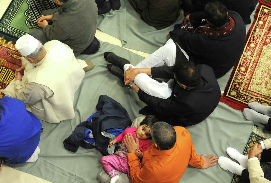 Area Muslims gather to pray together and give thanks for the safe completion of pilgrimage in celebration of Eidul Adha at the Muslim Community Center on Saturday Oct. 4, 2014 in Colonie, N.Y.  (Michael P. Farrell/Times Union) Photo: Michael P. Farrell / 00028871A