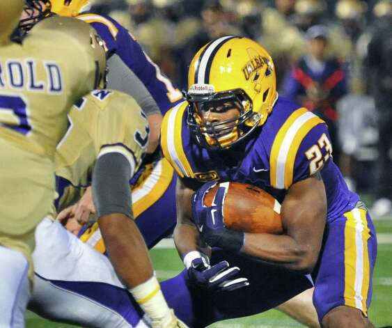 UAlbany's #23 Omar Osbourne tries to find a hole in the James Madison line during Saturday's Colonial Athletic Association game at University at Albany's Bob Ford Field Oct. 4, 2014, in Albany, NY.  (John Carl D'Annibale / Times Union) Photo: John Carl D'Annibale / 00028860A