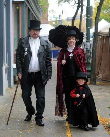 Rikk and Dona Anderson of Niskayuna with their two-year-old son Cylas dress in Steampunk fashion as they walk down River Street during the Queen Mab's Enchanted City Street Faire and family friendly Steampunk Festival on Saturday Oct. 4, 2014 in Troy, N.Y.  (Michael P. Farrell/Times Union) Photo: Michael P. Farrell / 00028875A