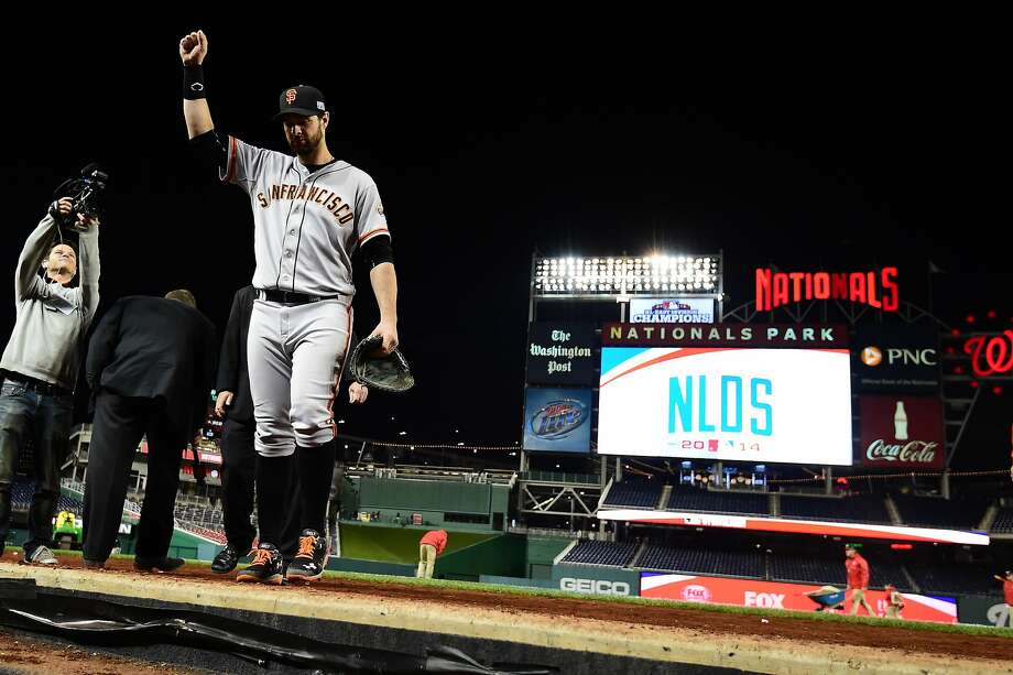 WASHINGTON, DC - OCTOBER 04:  Brandon Belt #9 of the San Francisco Giants celebrates after defeating the Washington Nationals in the eighteenth inning 2 to 1 in Game Two of the National League Division Series at Nationals Park on October 4, 2014 in Washington, DC.  (Photo by Patrick Smith/Getty Images) Photo: Patrick Smith, Getty Images