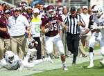 Mississippi State's Richie Brown (39) returns an interception during the first half of an NCAA college football game Texas A&M on Saturday, Oct. 4, 2014 at Davis Wade Stadium in Starkville, Miss. (AP Photo/The Clarion-Ledger, Kevin Warren)  NO SALES
