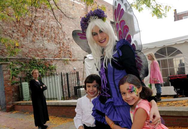 Eight-year-old twins Scarlett and Evelyn Kennedy pose with Queen Mab during the Queen Mab's Enchanted City Street Faire and family friendly Steampunk Festival on Saturday Oct. 4, 2014 in Troy, N.Y.  (Michael P. Farrell/Times Union) Photo: Michael P. Farrell / 00028875A