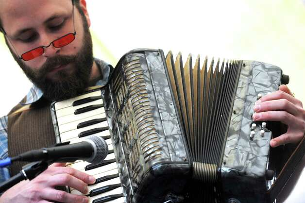 Louis Apicello plays accordion with the band Neighborhood of Make Believe during the Queen Mab's Enchanted City Street Faire and family friendly Steampunk Festival on Saturday Oct. 4, 2014 in Troy, N.Y.  (Michael P. Farrell/Times Union) Photo: Michael P. Farrell / 00028875A