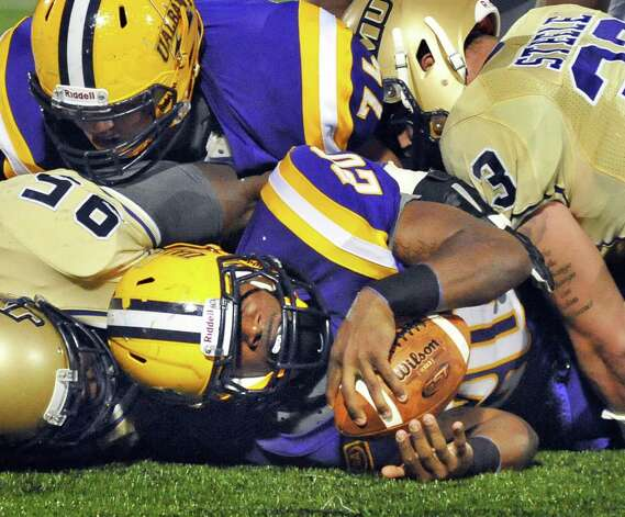 UAlbany's #23 Omar Osbourne, center, during Saturday's Colonial Athletic Association game against James Madison at University at Albany's Bob Ford Field Oct. 4, 2014, in Albany, NY.  (John Carl D'Annibale / Times Union) Photo: John Carl D'Annibale / 00028860A