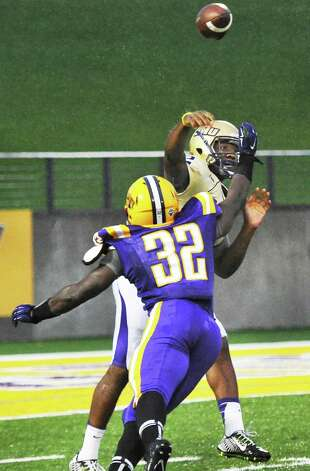 UAlbany's #32 Marcel Ngachie pressures James Madison QB Vad Lee during Saturday's Colonial Athletic Association game at University at Albany's Bob Ford Field Oct. 4, 2014, in Albany, NY.  (John Carl D'Annibale / Times Union) Photo: John Carl D'Annibale / 00028860A