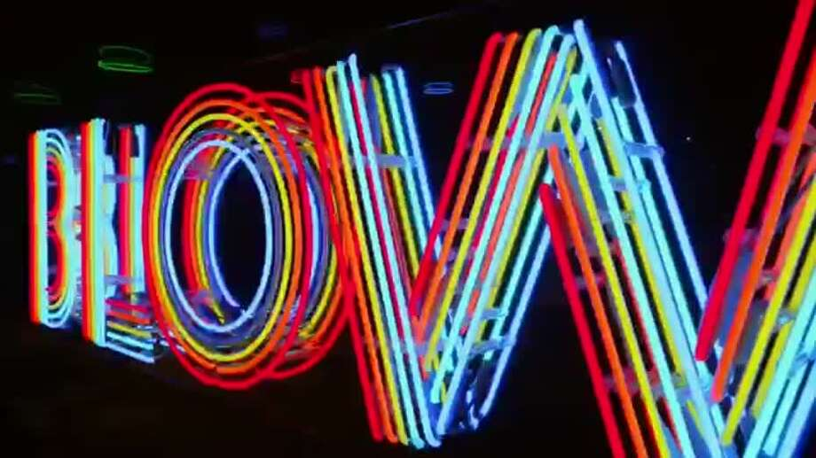 """""""Blow,"""" the sign Tim Walker's Neon Gallery made for Beyoncé's video. Photo: Screenshot From Beyonce's """"Blow"""""""