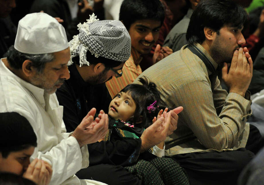 Parishoners look on during Eid-ul-Adha celebration and prayer at the Italian Center in Stamford, Conn., on Sunday, Oct. 5, 2014. Photo: Jason Rearick / Stamford Advocate
