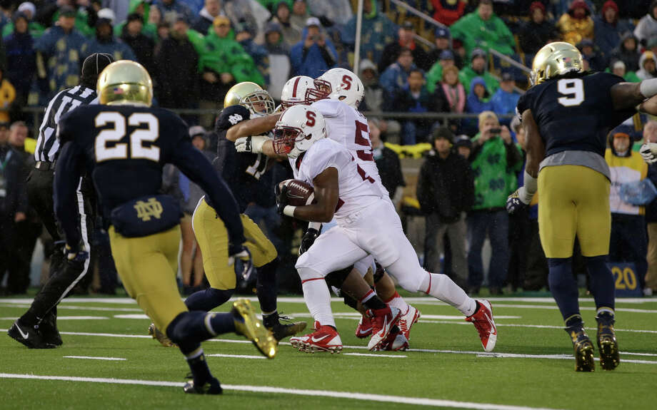 Remound Wright runs 11 yards for a fourth-quarter TD that put Stanford ahead, but only temporarily. Photo: Darron Cummings / Associated Press / AP