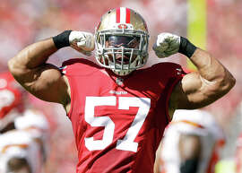 Michael Wilhoite, flexing after a tackle against the Chiefs last month, says he trusts team physicians about medications.