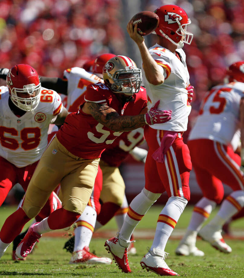 Aaron Lynch of the 49ers puts the pressure on Chiefs QB Alex Smith during the second quarter. Smith led Kansas City to a 17-13 lead early in the second half but was blanked the rest of the way. Photo: Scott Strazzante / The Chronicle / ONLINE_YES