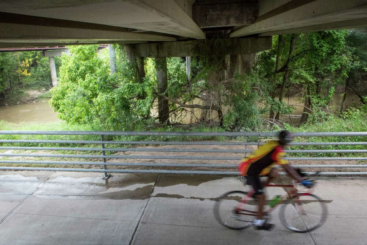 A cyclist speeds on a bike trail that passes under Eldridge Parkway in The Energy Corridor District on Sept. 22, 2014. Soon, people interested in their travel options will have a state-sponsored website and app to consult, which could lead them to choose bicycling.