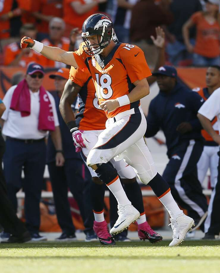 Denver Broncos quarterback Peyton Manning (18) runs upfield after a touchdown pass against the Arizona Cardinals during the second half of an NFL football game, Sunday, Oct. 5, 2014, in Denver. (AP Photo/Joe Mahoney) Photo: Joe Mahoney, Associated Press