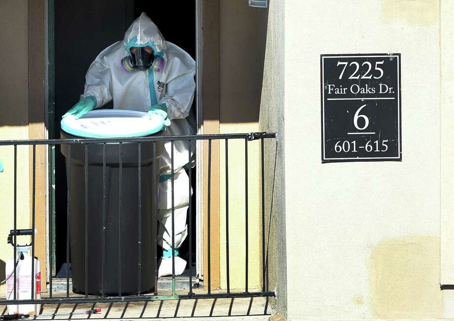A member of the Cleaning Guys hazmat cleanup company removes items from the apartment where Ebola patient Thomas Eric Duncan was staying. Photo: Joe Raedle, Staff / 2014 Getty Images