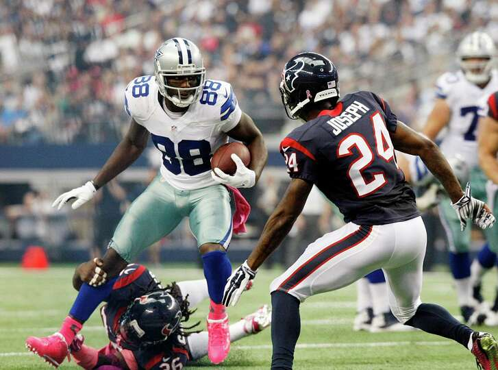 Dallas Cowboys wide receiver Dez Bryant (88) escapes from Houston Texans defensive back Danieal Manning (38) and  evades  Johnathan Joseph (24) during the second half of an NFL football game, Sunday, Oct. 5, 2014 in Arlington, Texas. (AP Photo/Waco Tribune Herald, Jose Yau)