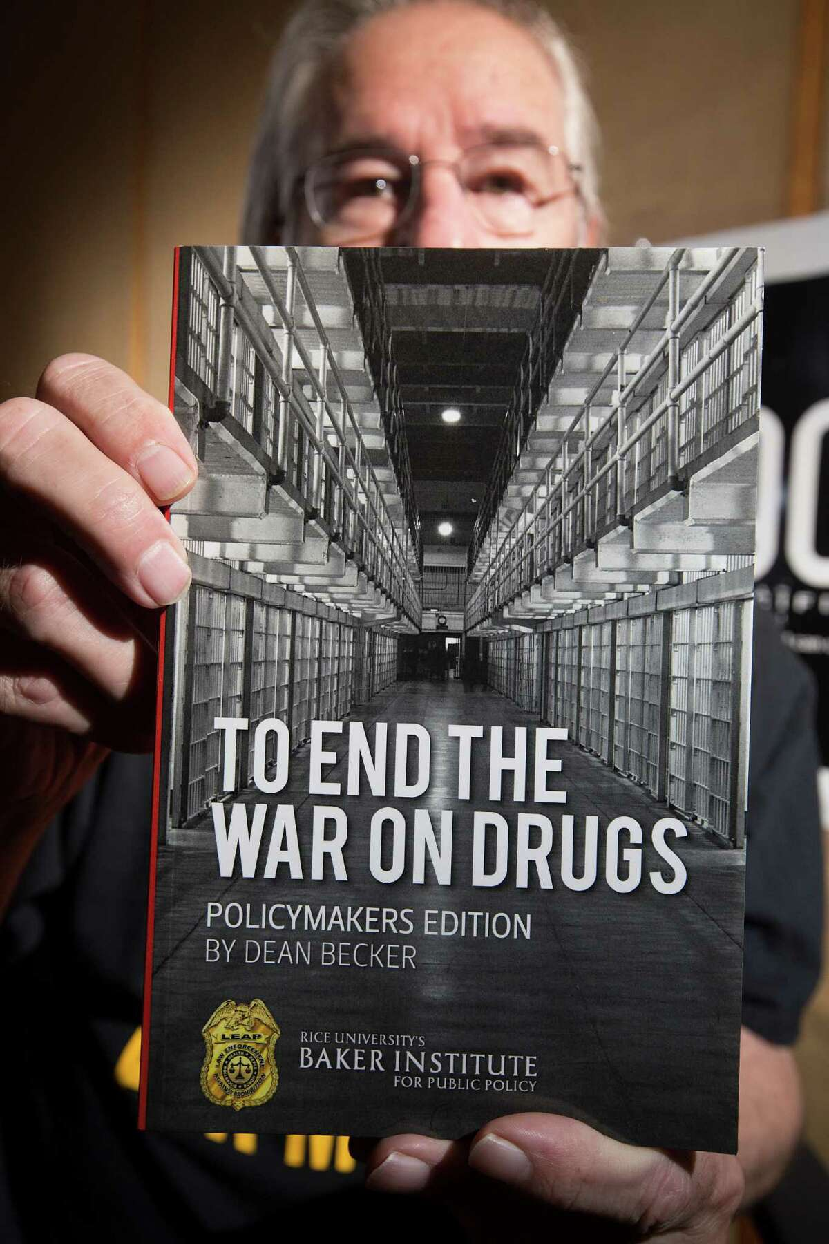 Portrait of Dean Becker, with his book, To End The War On Drugs, at Pacifica's KPFT studios where he is a reporter and produces nine radio programs each week for the Drug Truth Network Friday, Oct. 3, 2014, in Houston. Becker is a former police officer who joined the Law Enforcement Against Prohibition organization in 2002. He believes that all drugs should be legalized. ( Johnny Hanson / Houston Chronicle )