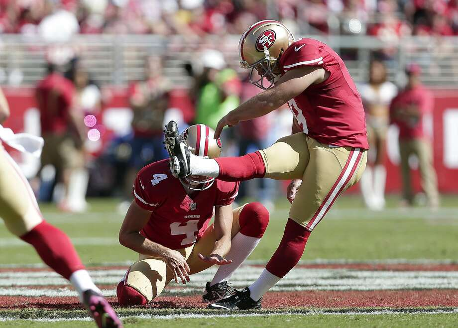 Andy Lee holds the ball for Phil Dawson to kick a field goal in a game against the Chiefs last year. Photo: Marcio Jose Sanchez, Associated Press